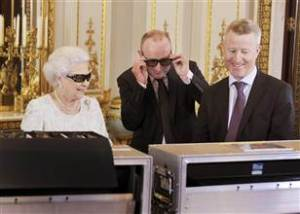 "The Queen gets a preview of her Christmas message with a pair of 3D glasses, complete with Swarovski crystals in the form of a ""Q""."