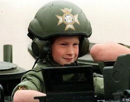 A young Prince Harry at the helm of a tank in 1993.