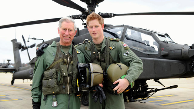 "Prince Harry is joined by his father Prince Charles upon his graduation in February 2012 as an Apache helicopter pilot. Harry won a prize for ""best co-pilot gunner"" out of the graduating pool of 20 other pilots."