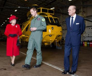 William gives his grandparents, the Queen and Duke of Edinburgh, a tour during their Royal visit to RAF Valley in April 2011.