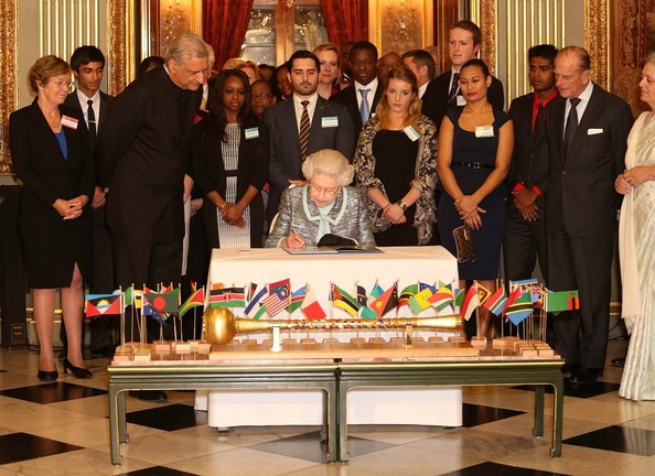 Still not quite recovered from the gastroenteritis that hospitalized her, the Queen signs the Commonwealth Charter on March 11, 2013.