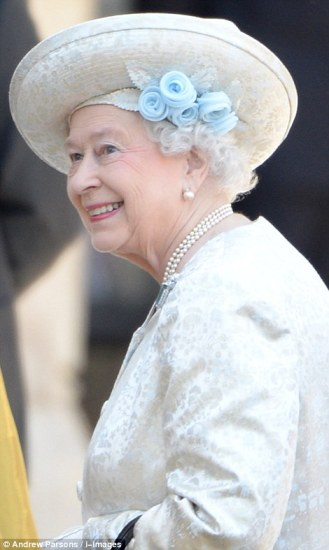 Looking pretty in an Angela Kelly dress, hat and coat, the Queen arrives for the anniversary celebration service.