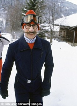In Switzerland in 1980, Charles tries a disguise to fool waiting photographers (it didn't work).