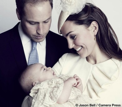 Prince George shares a smile with his parents on the day of his christening.