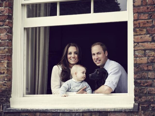 In this official photo released prior to their trip, George and family pet Lupo gaze adoringly at each other. Undoubtedly George will miss his best friend during his time away.