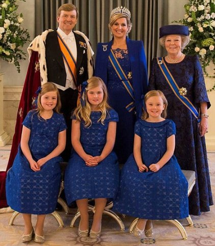 With former Queen Beatrix smiling proudly, the new King of the Netherlands, Willem-Alexander, and his wife, Queen Maxima, celebrate their coronation day with their daughters.